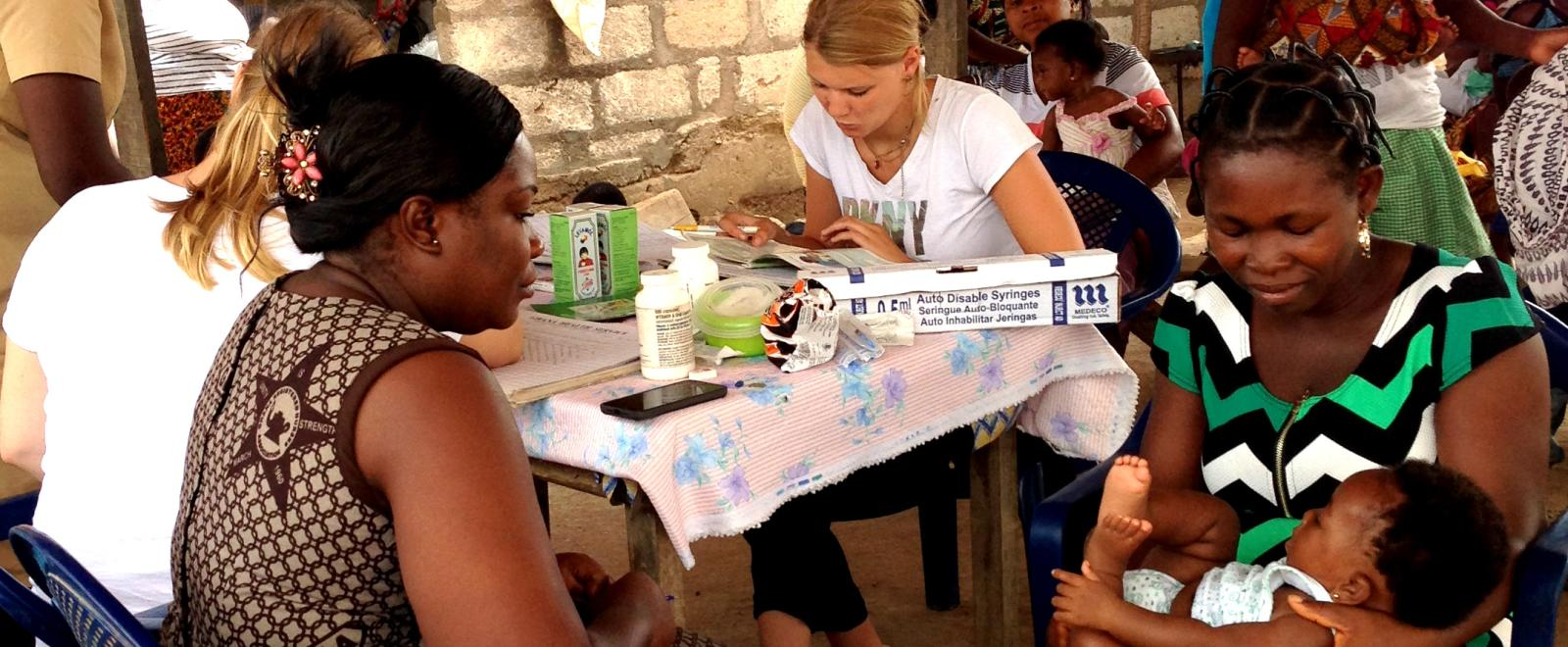 Projects Abroad Midwifery interns participate in a community healthcare outreach in a rural part of Ghana.
